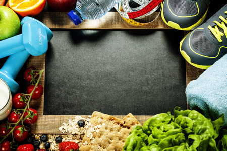 Foto de Different tools for sport and diet food - sport, health and diet concept - Imagen libre de derechos