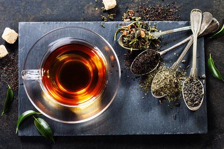 Photo for Tea composition with old spoon on dark background - Royalty Free Image