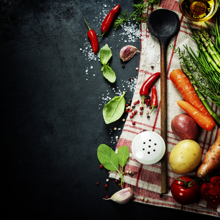 Photo pour Wooden spoon and ingredients on dark background - image libre de droit