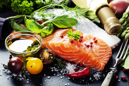 Photo pour Delicious  portion of fresh salmon fillet  with aromatic herbs, spices and vegetables - healthy food, diet or cooking concept - image libre de droit