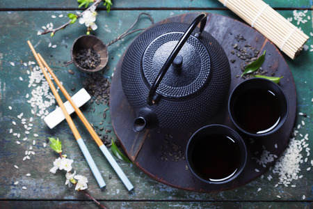 Photo for Chinese Tea Set and chopsticks on rustic wooden table - Royalty Free Image
