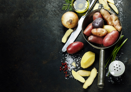 Foto de Potato preparation. Fresh organic vegetables. Food background. Healthy food from garden - Imagen libre de derechos