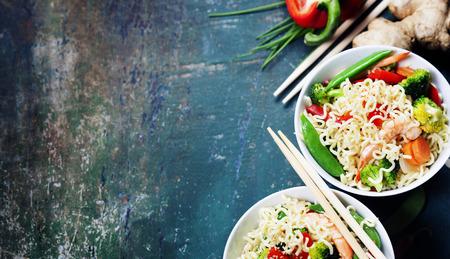 Photo pour Chinese noodles with vegetables and shrimps. Food background - image libre de droit