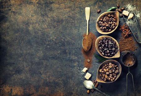Foto de Top view of three different varieties of coffee beans on dark vintage background - Imagen libre de derechos