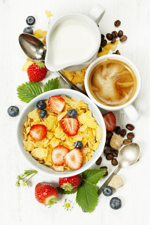 Photo for Healthy Breakfast with coffee, corn flakes, milk and berry on old wooden background. Health and diet concept - Royalty Free Image