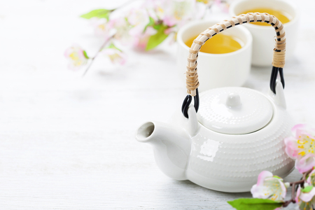 Photo for Chinese Tea Set  and sakura branch on bamboo mat - Royalty Free Image
