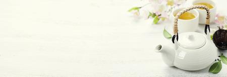 Photo pour Chinese Tea Set  and sakura branch on bamboo mat - image libre de droit