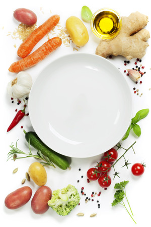 Photo for Fresh vegetables around empty white plate, top view, copy space - Royalty Free Image