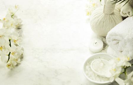 Photo pour Spa background (white orchid, herbal compress stamps, sea salt, towel and massage stones) - image libre de droit