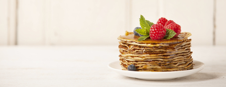 Photo for Stack of pancakes topped with berries and honey - Royalty Free Image