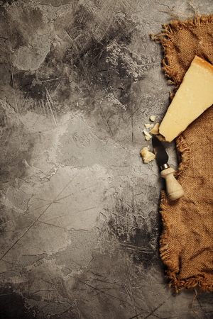 Photo for Food background with parmesan cheese over dark stone background. Lots of copy space - Royalty Free Image