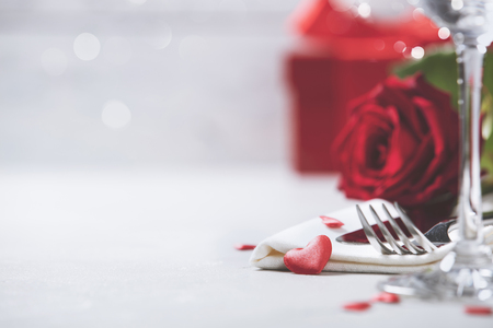 Photo for Valentine's Day or Romantic dinner concept. Valentine day or proposal background. Close up view of restaurant table with romantic table place setting. Copy space  - Royalty Free Image
