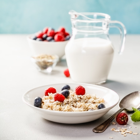 Photo for Oatmeal porridge with fresh berries and almond milk. Healthy breakfast, healthy eating, vegan food concept. - Royalty Free Image