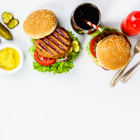 Photo pour Homemade hamburgers, flat lay - image libre de droit