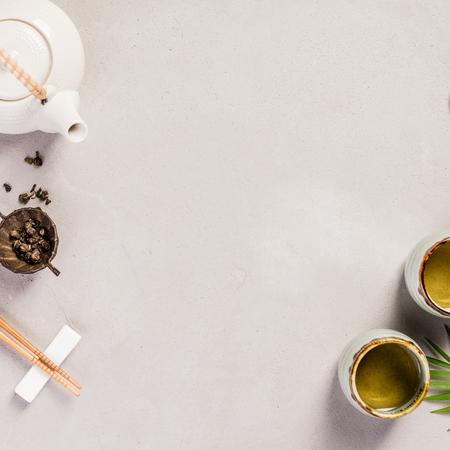 Photo pour Asian food background - tea and chopsticks on a grey concrete background. Top view, flat lay - image libre de droit
