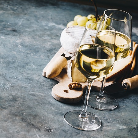 Photo for White wine with charcuterie assortment on the stone - Royalty Free Image