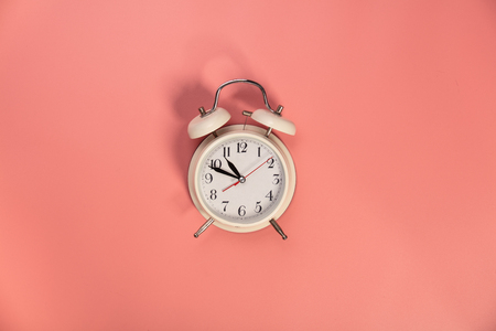 Photo for White alarm clock on pink background - flat lay - Royalty Free Image
