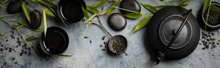 Photo pour Bamboo branches and green tea on concrete background - image libre de droit