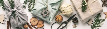 Foto de Fabric wrapped gifts and wooden Christmas decorations - Imagen libre de derechos