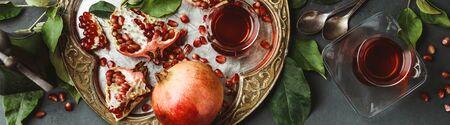 Foto de Pomegranate tea on dark background, flat lay - Imagen libre de derechos
