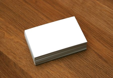 Blank business cards stacked up on a desk - insert your own design