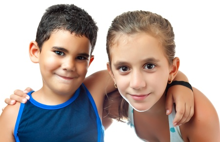 Latin girl hugging her younger brother isolated on a white background