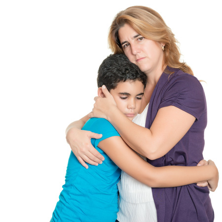 Foto de Sad mother hugging her son isolated on a white background - Imagen libre de derechos