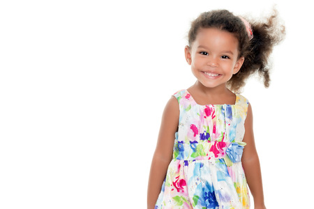 Photo pour Cute small african-american or hispanic girl wearing a flowers summer dress isolated on white - image libre de droit