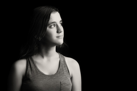 Beautiful low key black and white portrait of a teenage girl