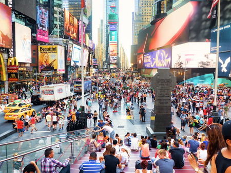 Foto für Tourists and colorful neon billboards at Times Square in New York City - Lizenzfreies Bild