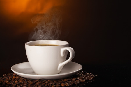 Foto für cup of coffee and coffee beans over dark background - Lizenzfreies Bild