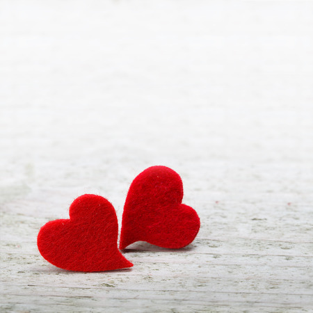 Foto de valentines day background with two hearts on wooden background - Imagen libre de derechos