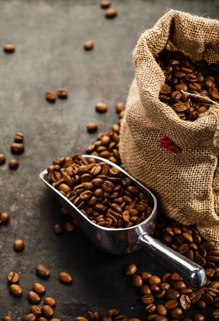 Foto de Cup of coffee, bag and scoop on old rusty background - Imagen libre de derechos