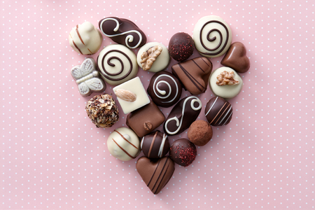 Photo for Chocolate candies heart shape composition. Sweet gift of love for St. Valentines Day. - Royalty Free Image