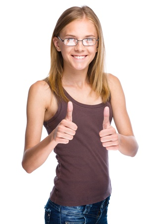 Young woman dressed in blue is showing thumb up gesture using both hands, isolated over white