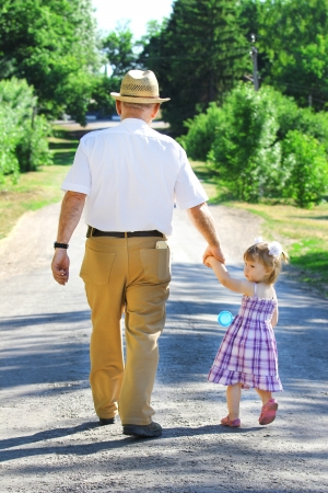 grandfather and granddaughter are on the road
