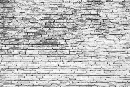 Foto de Cracked white grunge brick wall background - Imagen libre de derechos