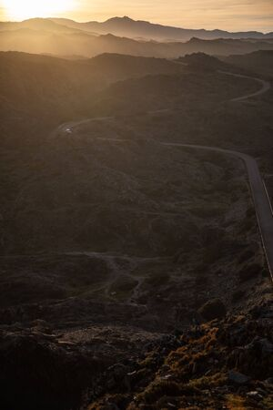 Foto de View of a mountain curved road with sunset sky in Cap de Creus, Catalunya - Imagen libre de derechos