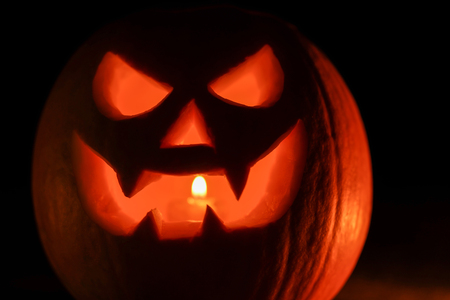 Photo for Orange mad pumpkin as head of Jack-o-lantern with carved eyes and wicked smirk. Scary symbol of Halloween. Gourd on the left side. - Royalty Free Image