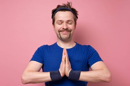 Photo pour peaceful funny man with mustache in holding hands in namaste or prayer, meditating. - image libre de droit