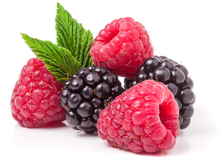 Photo for pile of raspberries and blackberries with leaves isolated on white background. - Royalty Free Image