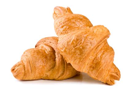 Foto de two croissant isolated over a white background closeup - Imagen libre de derechos