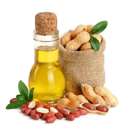 Foto de peanut oil in a glass bottle with peanuts in bag. - Imagen libre de derechos
