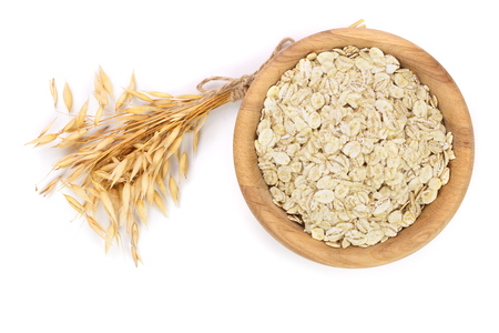 Photo for oat spike with oat flakes in wooden bowl isolated on white background. - Royalty Free Image