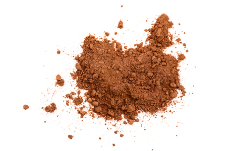 Foto de pile of cocoa powder isolated on white background. Top view. Flat lay - Imagen libre de derechos