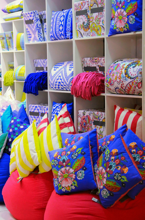 decorative pillows bright interior decoration for sale in a shop in the window