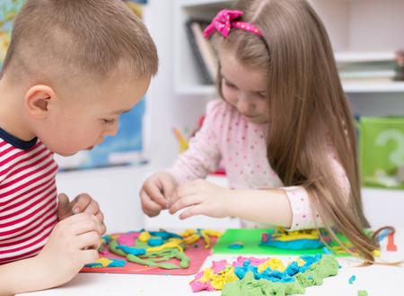 Foto de children Playing with clay - Imagen libre de derechos