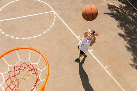 Photo for High Angle View of Young Man Playing Basketball, View from Above Hoop of Man Shooting Basketball - Royalty Free Image