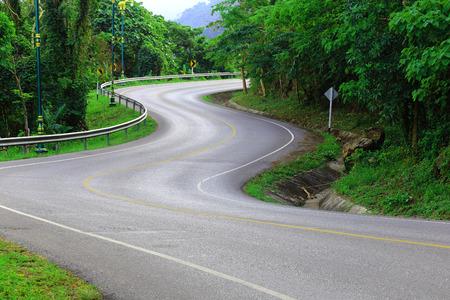 Photo pour Curve way of asphalt road in the green view. - image libre de droit