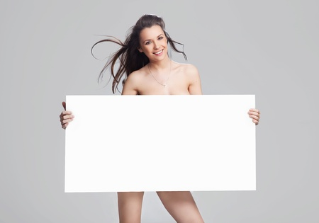 Young happy woman over white board